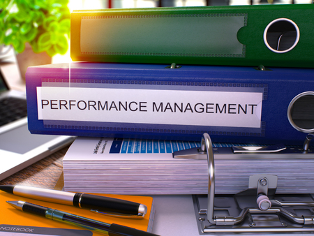 performance management: Blue Office Folder with Inscription Performance Management on Office Desktop with Office Supplies and Modern Laptop. Performance Management Business Concept on Blurred Background. 3D Render.