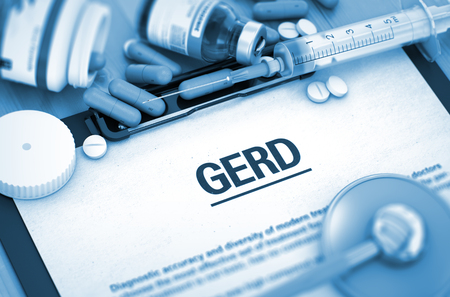 gastrointestinal system: GERD - Printed Diagnosis with Blurred Text. GERD, Medical Concept with Pills, Injections and Syringe. Toned Image. 3D Rendering.
