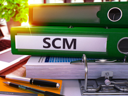 scm: Green Office Folder with Inscription SCM - Supply Chain Management - on Office Desktop with Office Supplies and Modern Laptop. SCM Business Concept on Blurred Background. SCM - Toned Image. 3D. Stock Photo
