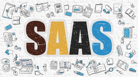 saas: SaaS - Software as a Service. Multicolor Inscription on White Brick Wall with Doodle Icons Around. SaaS - Software as a Service - Concept. Modern Style Illustration with Doodle Design Icons.
