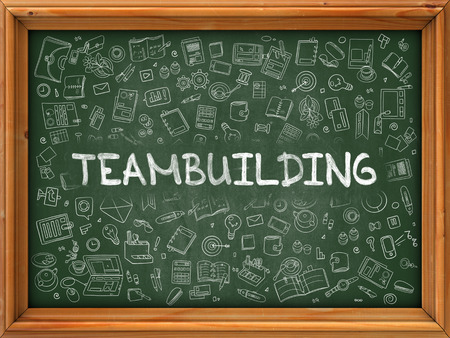 teambuilding: Teambuilding Concept. Modern Line Style Illustration. Teambuilding Handwritten on Green Chalkboard with Doodle Icons Around. Doodle Design Style of Teambuilding Concept. Stock Photo