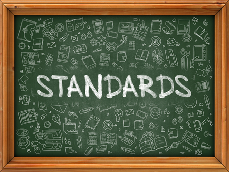 standards: Standards - Handwritten Inscription by Chalk on Green Chalkboard with Doodle Icons Around. Modern Style with Doodle Design Icons. Standards on Background of Green Chalkboard with Wood Border.