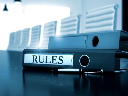injunction: Rules - Folder on Black Wooden Desktop. Rules. Concept on Blurred Background. Rules - Illustration. Ring Binder with Inscription Rules on Office Desktop. 3D.