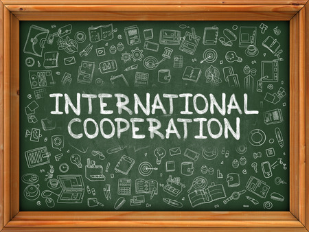 reciprocity: Hand Drawn International Cooperation on Green Chalkboard. Hand Drawn Doodle Icons Around Chalkboard. Modern Illustration with Line Style. Stock Photo
