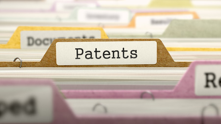 patents: File Folder Labeled as Patents in Multicolor Archive. Closeup View. Blurred Image. 3D Render.