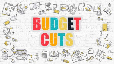 deficit: Budget Cuts Concept. Modern Line Style Illustration. Multicolor Budget Cuts Drawn on White Brick Wall. Doodle Icons. Doodle Design Style of  Budget Cuts Concept. Stock Photo