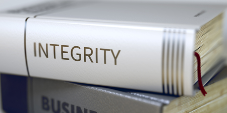 book spines: Integrity. Stack of Business Books. Book Spines with Title - Integrity. Closeup View. Integrity - Book Title. Business Book Title. Integrity. Blurred Image. Selective focus. 3D Rendering.