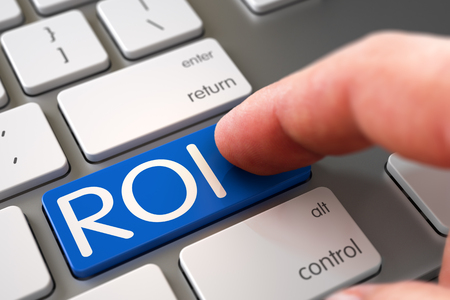 Selective Focus on the ROI Button. Hand of Young Man on ROI Blue Button. Man Finger Pressing ROI Button on Metallic Keyboard. Man Finger Pushing ROI Blue Button on Computer Keyboard. 3D.