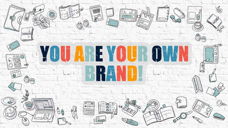 あなた自身のブランドがあります。落書きアイコンで白いレンガの壁に多色の碑文。落書きデザイン アイコンとイラストでモダンなスタイル。白ブ 写真素材