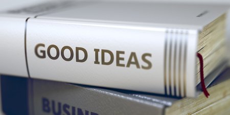 book spines: Business - Book Title. Good Ideas. Stack of Business Books. Book Spines with Title - Good Ideas. Closeup View. Stack of Books Closeup and one with Title - Good Ideas. Blurred Image. 3D.