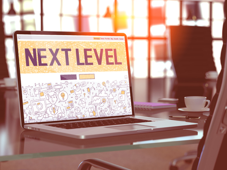 ensuing: Next Level Concept. Closeup Landing Page on Laptop Screen in Doodle Design Style. On Background of Comfortable Working Place in Modern Office. Blurred, Toned Image. 3D Render. Stock Photo