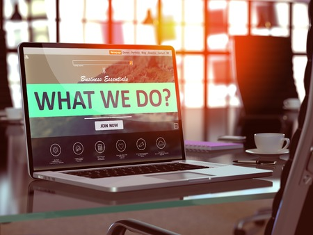 What We Do Concept. Closeup Landing Page on Laptop Screen  on background of Comfortable Working Place in Modern Office. Blurred, Toned Image. 3D Render.