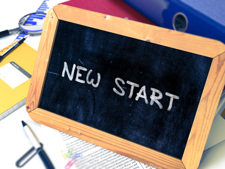 new start: New Start Handwritten by White Chalk on a Blackboard. Composition with Small Chalkboard on Background of Working Table with Office Folders, Stationery, Reports. Blurred, Toned Image. 3D Render.
