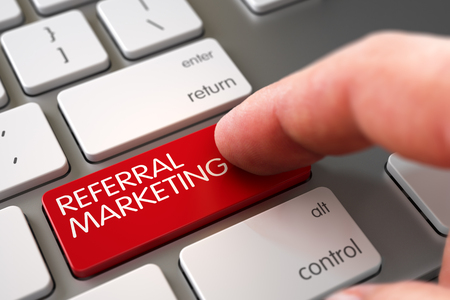 referral marketing: Selective Focus on the Referral Marketing Button. Man Finger Pressing Referral Marketing Button on Modernized Keyboard. Close Up view of Male Hand Touching Referral Marketing Computer Button. 3D.