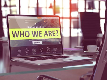 Who We Are Concept Closeup on Laptop Screen in Modern Office Workplace. Toned Image with Selective Focus. 3d Rendering. Banco de Imagens