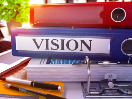 blurred vision: Vision - Blue Ring Binder on Office Desktop with Office Supplies and Modern Laptop. Vision Business Concept on Blurred Background. Vision - Toned Illustration. 3D Render.