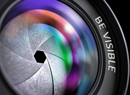 visible: Be Visible - Concept on Lens of Digital Camera with Colored Lens Reflection, Closeup. Be Visible Concept. Closeup Camera Lens with Pink and Orange Reflection. Black Background. 3D Render. Stock Photo