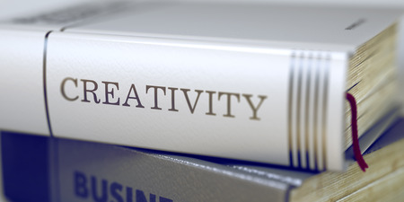 title: Creativity - Leather-bound Book in the Stack. Closeup. Book Title of Creativity. Stack of Books Closeup and one with Title - Creativity. Creativity Concept. Book Title. Blurred 3D Illustration.