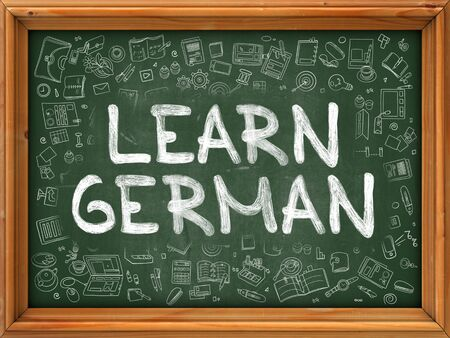 polyglot: Learn German Concept. Modern Line Style Illustration. Learn German Handwritten on Green Chalkboard with Doodle Icons Around. Doodle Design Style of  Learn German Concept.