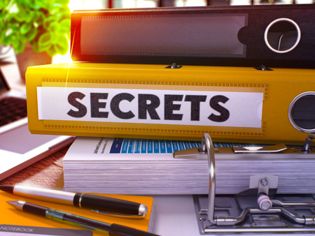 arcanum: Yellow Office Folder with Inscription Secrets on Office Desktop with Office Supplies and Modern Laptop. Secrets Business Concept on Blurred Background. Secrets - Toned Image. 3D. Stock Photo