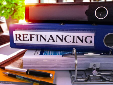 refinancing: Refinancing - Blue Ring Binder on Office Desktop with Office Supplies and Modern Laptop. Refinancing Business Concept on Blurred Background. Refinancing - Toned Illustration. 3D Render. Stock Photo