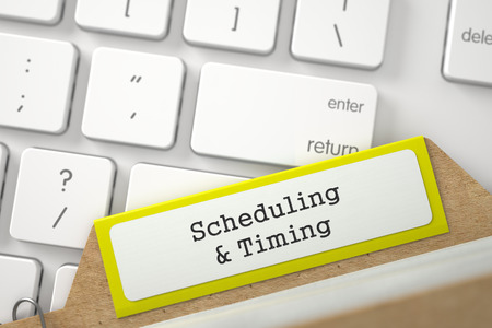 card file: Scheduling & Timing. Yellow Card File Concept on Background of White Modern Computer Keyboard. Archive Concept. Closeup View. Blurred Image. 3D Rendering. Stock Photo