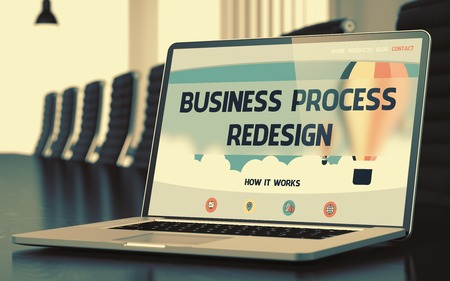 redesign: Business Process Redesign. Modern Meeting Room with Laptop Showing Landing Page with Text Business Process Redesign. Closeup View. Toned Image. Blurred Background. 3D Rendering.