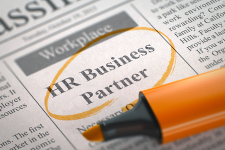 organisational: HR Business Partner. Newspaper with the Small Advertising, Circled with a Orange Highlighter. Blurred Image with Selective focus. Concept of Recruitment. 3D.