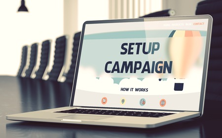successful campaign: Mobile Computer Display with Setup Campaign Concept on Landing Page. Closeup View. Modern Meeting Hall Background. Blurred Image with Selective focus. 3D Render.