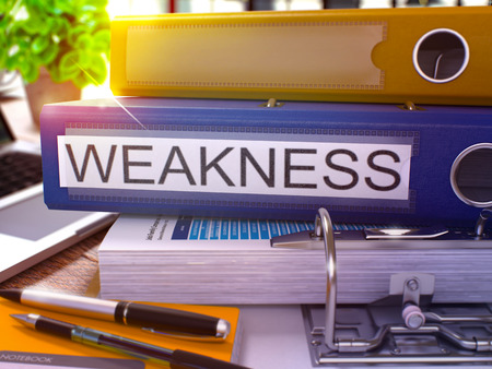 weakness: Weakness - Blue Office Folder on Background of Working Table with Stationery and Laptop. Weakness Business Concept on Blurred Background. Weakness Toned Image. 3D.