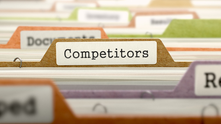 gestion documental: Los competidores del concepto sobre el Registro de carpetas en el �ndice de tarjeta multicolor. Primer punto de vista. Enfoque selectivo. Render 3D. Foto de archivo