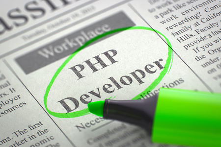 java script: A Newspaper Column in the Classifieds with the Jobs of PHP Developer, Circled with a Green Marker. Blurred Image with Selective focus. Job Search Concept. 3D Render. Stock Photo