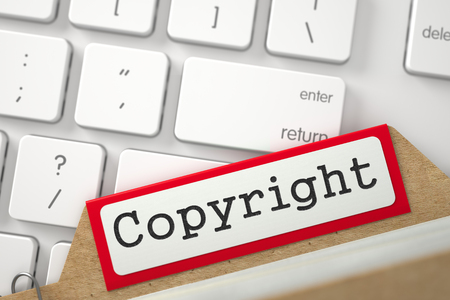 plagiarism: Copyright. Red Folder Register on Background of Computer Keyboard. Archive Concept. Closeup View. Blurred Image. 3D Rendering.