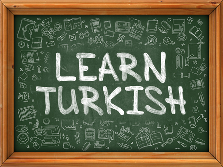 polyglot: Green Chalkboard with Hand Drawn Learn Turkish with Doodle Icons Around. Line Style Illustration. Stock Photo