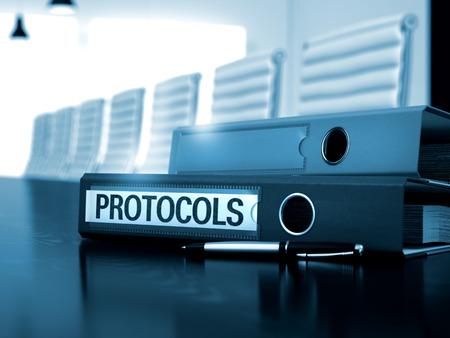 protocols: Protocols. Illustration on Blurred Background. Protocols - Office Binder on Black Table. Binder with Inscription Protocols on Wooden Table. 3D.