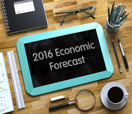 economic forecast: 2016 Economic Forecast Concept on Small Chalkboard. 2016 Economic Forecast - Mint Small Chalkboard with Hand Drawn Text and Stationery on Office Desk. Top View. 3d Rendering.
