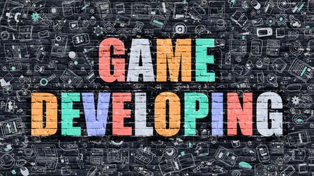 developing: Game Developing. Multicolor Inscription on Dark Brick Wall with Doodle Icons. Game Developing Concept in Modern Style. Doodle Design Icons. Game Developing on Dark Brickwall Background. Stock Photo