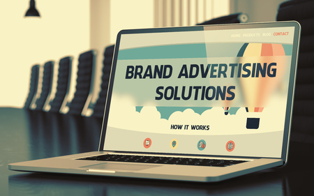conference hall: Brand Advertising Solutions on Landing Page of Laptop Screen. Closeup View. Modern Conference Hall Background. Toned. Blurred Image. 3D Illustration. Stock Photo