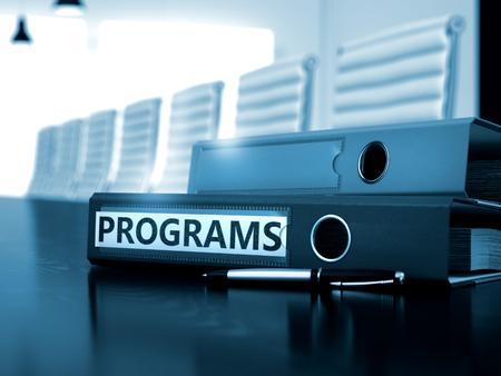 programs: Programs - Folder on Office Working Desktop. Programs - Concept. Programs. Business Illustration on Blurred Background. File Folder with Inscription Programs on Office Table. 3D. Stock Photo