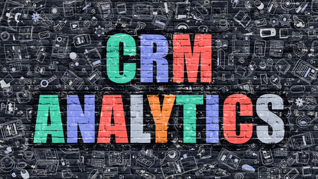 CRM Analytics. Multicolor Inscription on Dark Brick Wall with Doodle Icons. CRM Analytics Concept in Modern Style. Doodle Design Icons. CRM Analytics on Dark Brickwall Background. Stock Photo