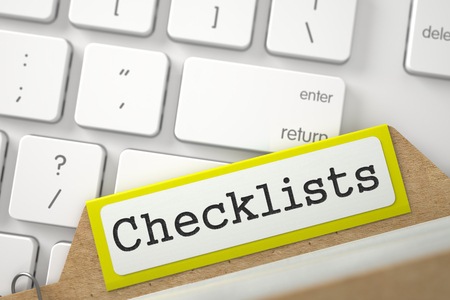 card file: Checklists. Yellow Card File Concept on Background of White PC Keyboard. Archive Concept. Close Up View. Selective Focus. 3D Rendering.