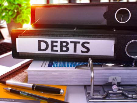 repayment: Debts - Black Office Folder on Background of Working Table with Stationery and Laptop. Debts Business Concept on Blurred Background. Debts Toned Image. 3D.