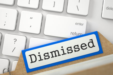 unemployed dismissed: Dismissed. Orange Index Card Concept on Background of White PC Keypad. Business Concept. Closeup View. Selective Focus. 3D Rendering. Stock Photo