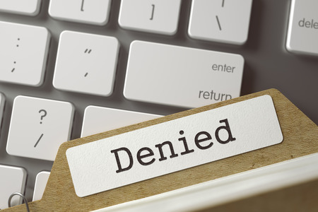 disclaim: Denied. Card File on Background of White Modern Computer Keypad. Business Concept. Closeup View. Selective Focus. Toned Illustration. 3D Rendering.