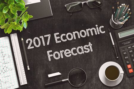 economic forecast: Business Concept - 2017 Economic Forecast Handwritten on Black Chalkboard. Top View Composition with Chalkboard and Office Supplies on Office Desk. 3d Rendering. Toned Illustration.