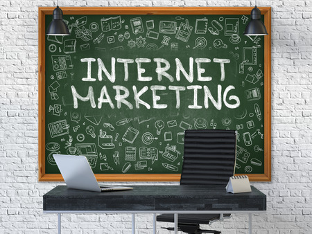 Internet Marketing - Hand Drawn on Green Chalkboard in Modern Office Workplace. Illustration with Doodle Design Elements. 3D. Stock Photo