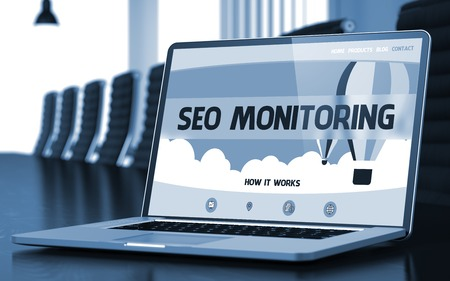 rewriting: SEO Monitoring - Landing Page with Inscription on Laptop Screen on Background of Comfortable Meeting Room in Modern Office. Closeup View. Blurred Image with Selective focus. 3D Rendering.