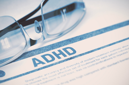 medical attention: ADHD - Attention Deficit Hyperactivity Disorder - Printed Diagnosis with Blurred Text on Blue Background with Spectacles. Medical Concept. 3D Rendering. Stock Photo
