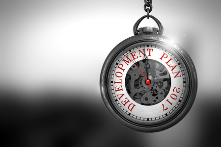 Development Plan 2017 Close Up of Red Text on the Vintage Pocket Clock Face. Development Plan 2017 on Pocket Watch Face with Close View of Watch Mechanism. Business Concept. 3D Rendering. Stock Photo