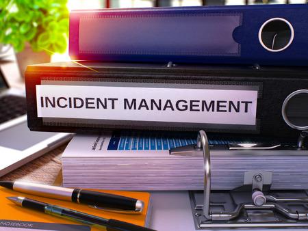 incident: Black Office Folder with Inscription Incident Management on Office Desktop with Office Supplies and Modern Laptop. Incident Management Business Concept on Blurred Background. 3D Render.